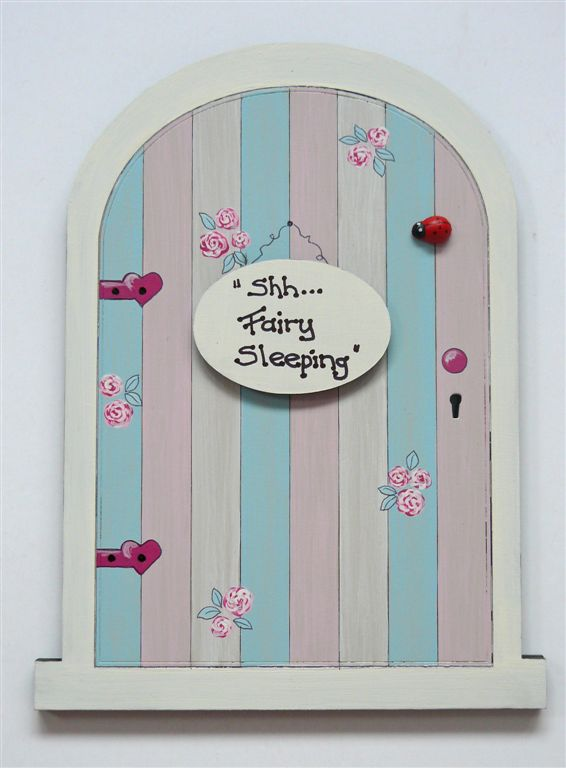Fairy door with roses and vertical stripes